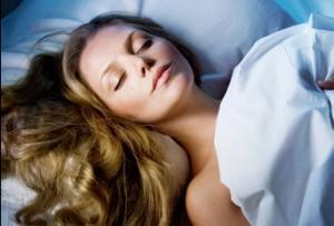 Beautiful Young Woman Sleeping at night.