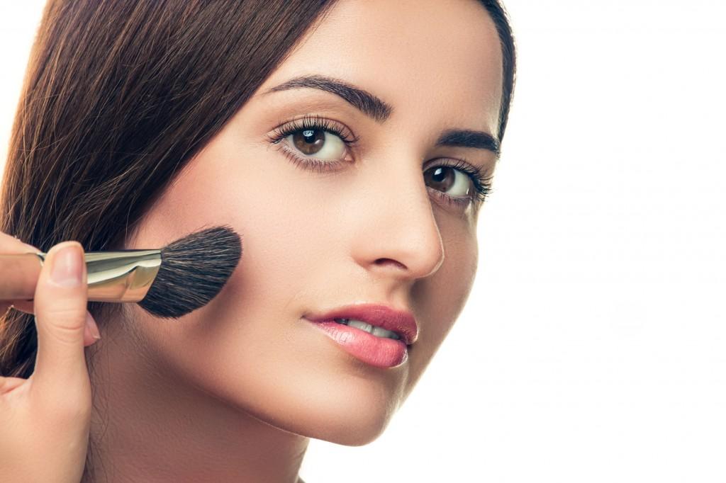 31580922 - beauty girl with makeup brush. perfect skin. applying makeup