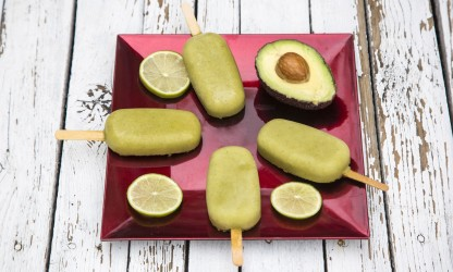 41216842 - popsicles, acocado ice, lime on plate