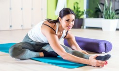55651005 - fit woman doing stretching pilates exercises in fitness studio