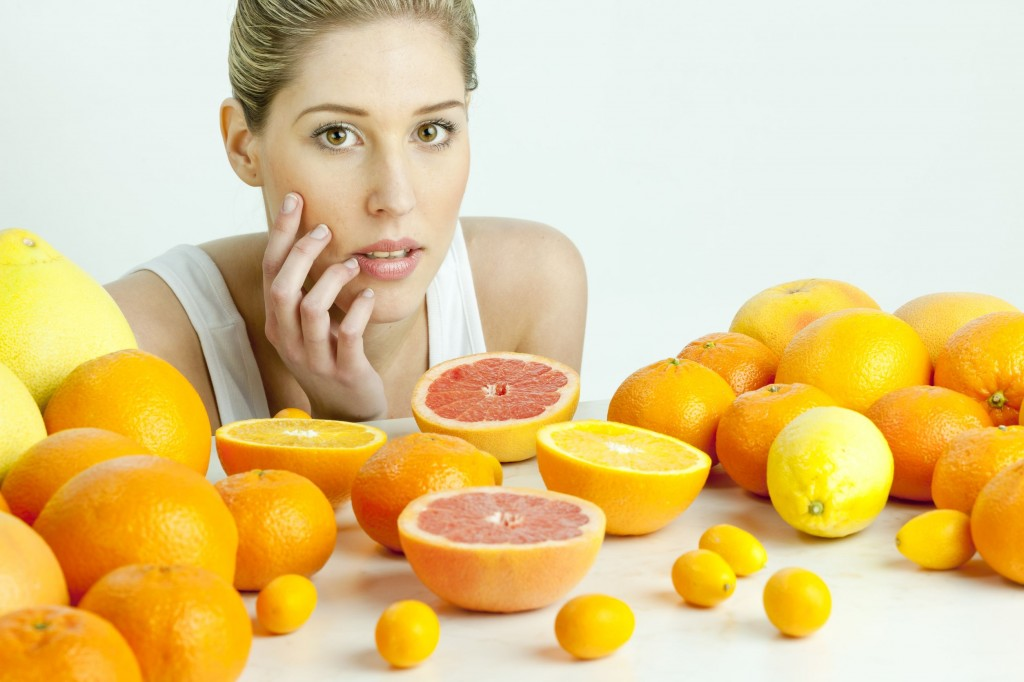 13678769 - portrait of young woman with citrus fruit