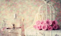 35106746 - roses over vintage book, perfume bottles and lacre seal