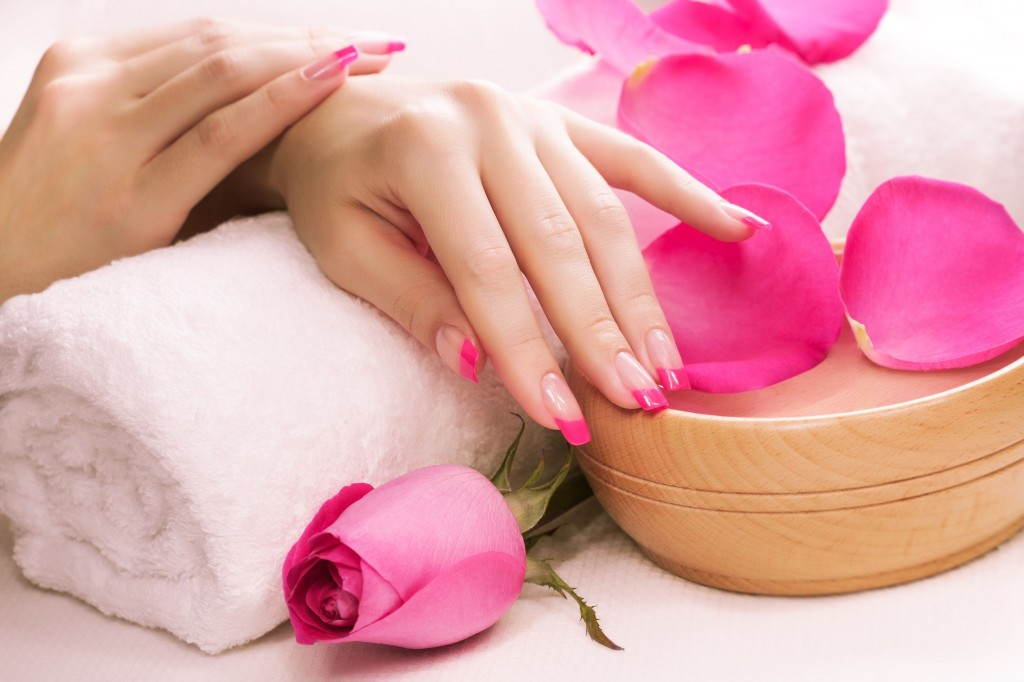 18539964 - beautiful manicure with fragrant rose petals and towel