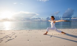 19867200 - caucasian woman practicing yoga at seashore