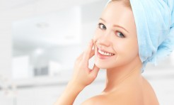 32696888 - skin care. young beautiful healthy girl in a towel in the bathroom