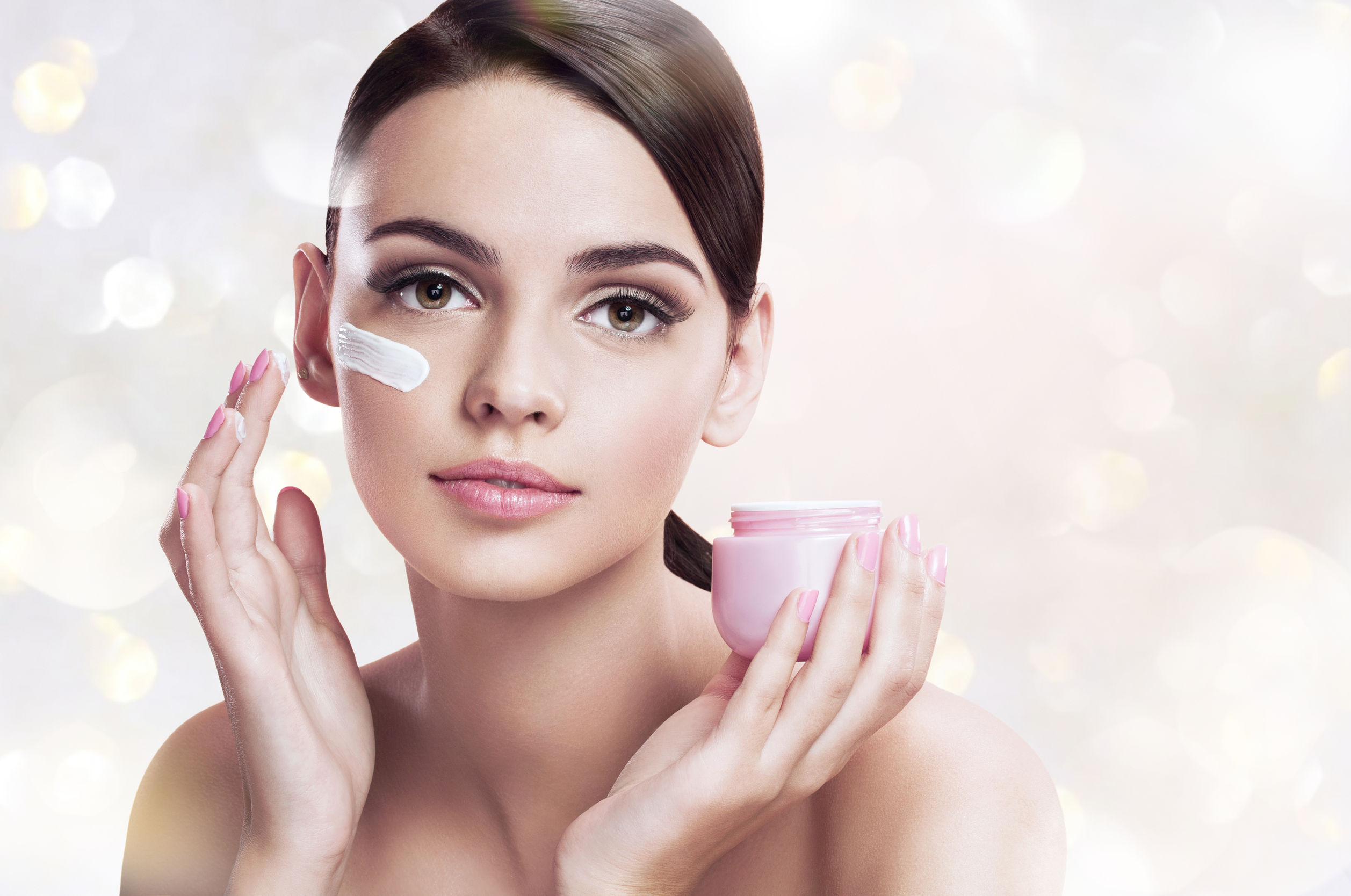 38022079 - beautiful young woman applying moisturizing creme, skin care concept