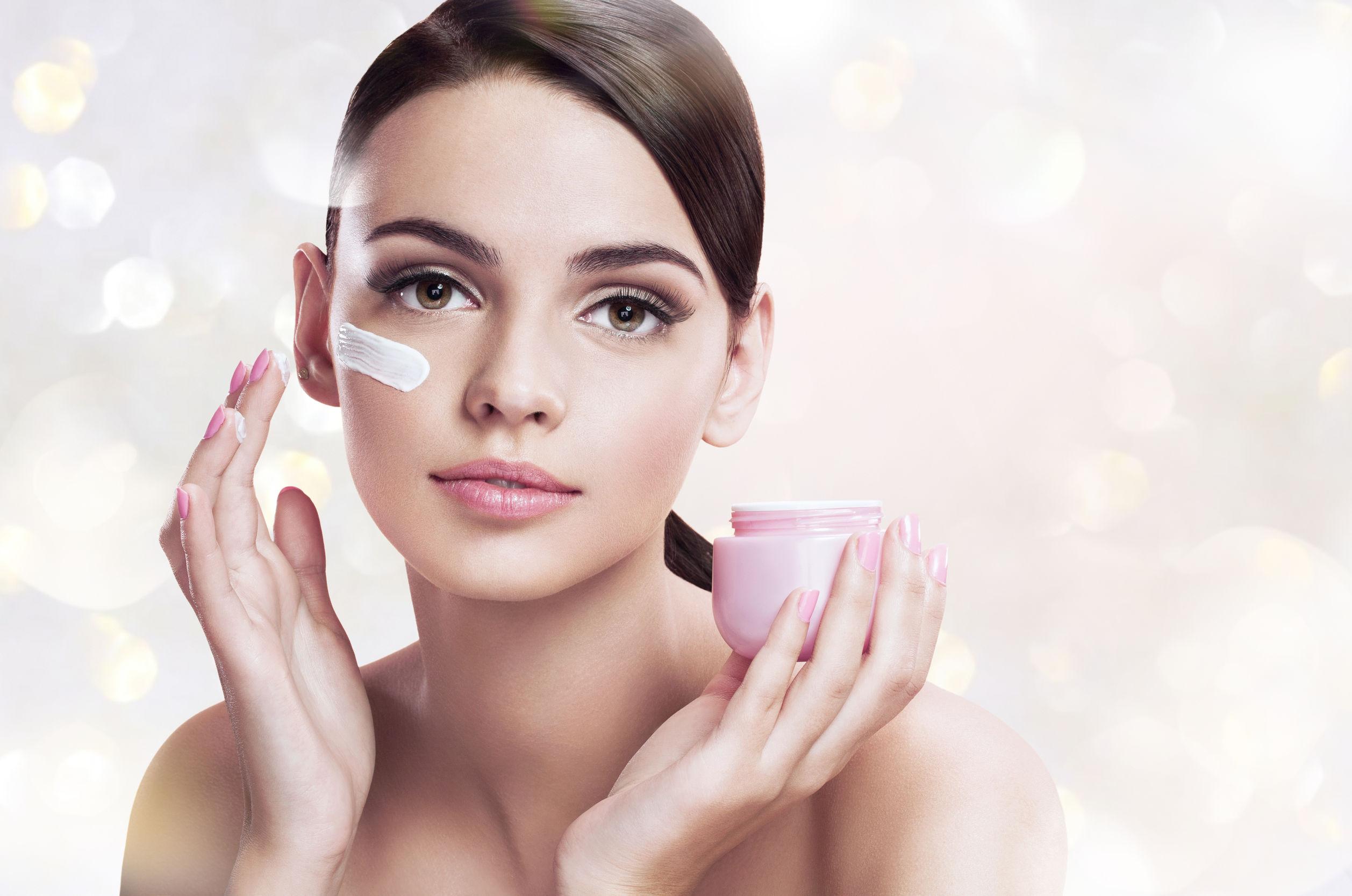 38022079 - beautiful young woman applying moisturizing creme, skin care concept