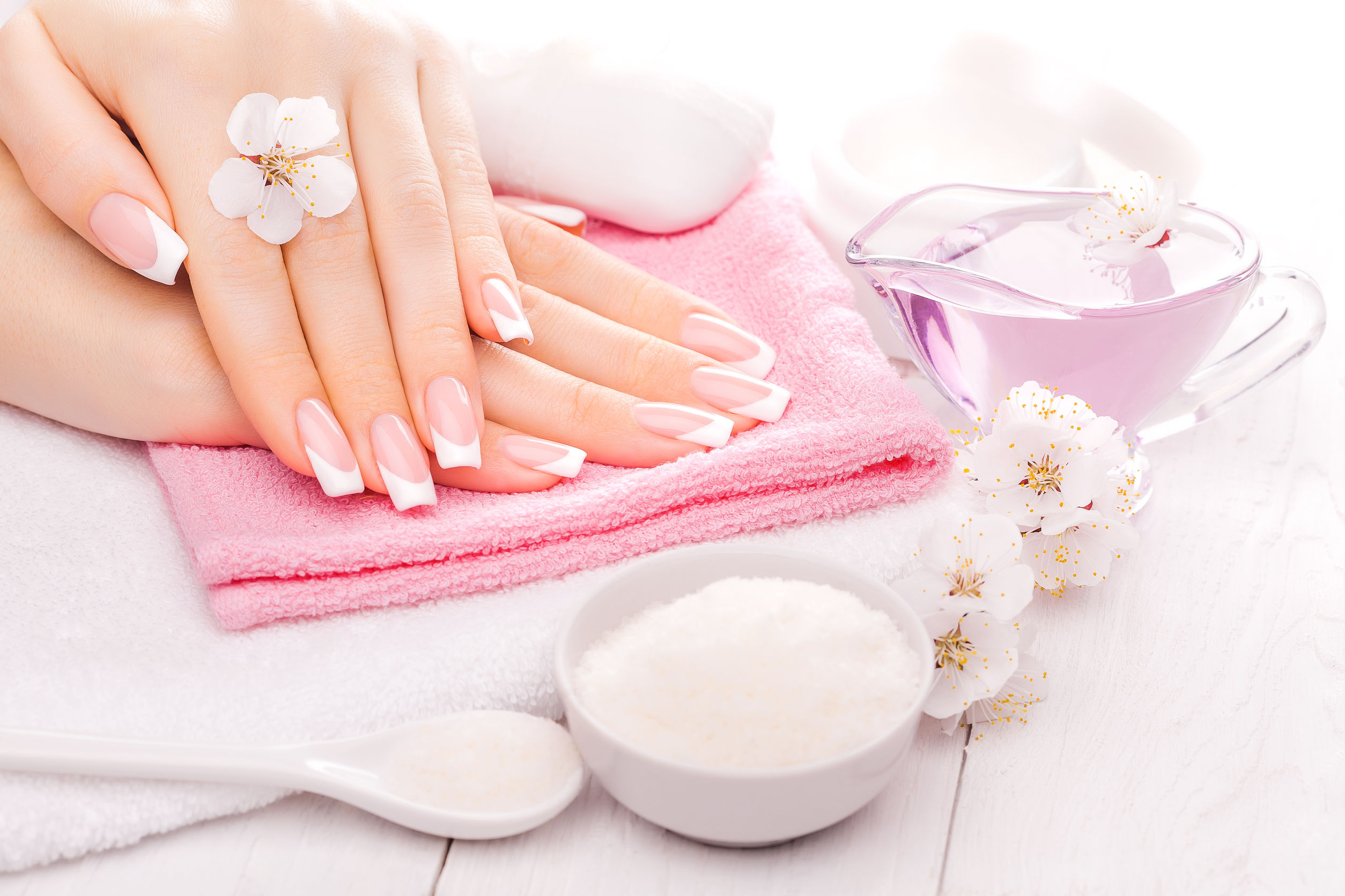 39600576 - french manicure with essential oils, apricot flowers. spa
