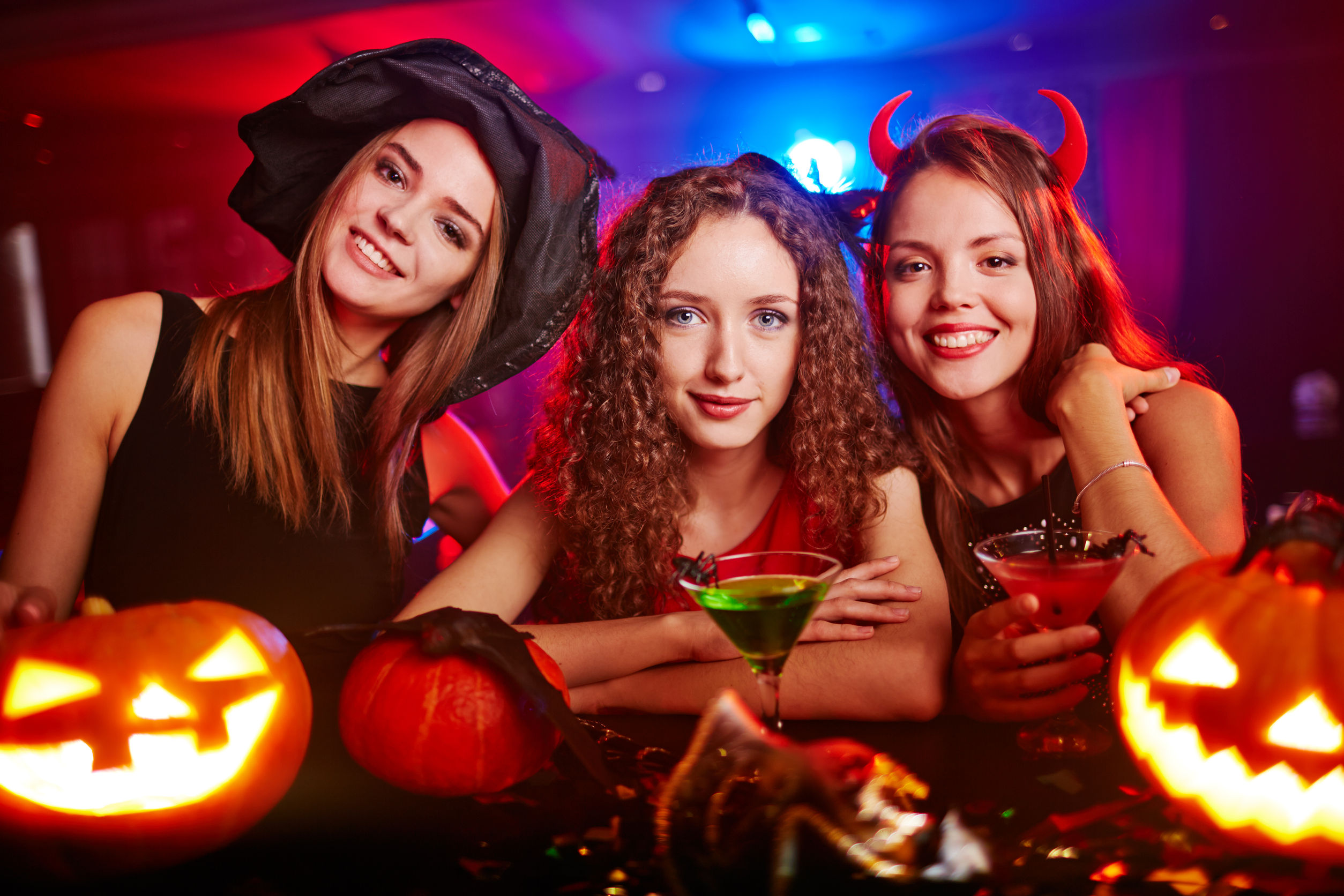 44207208 - portrait of three girlfriends at halloween night