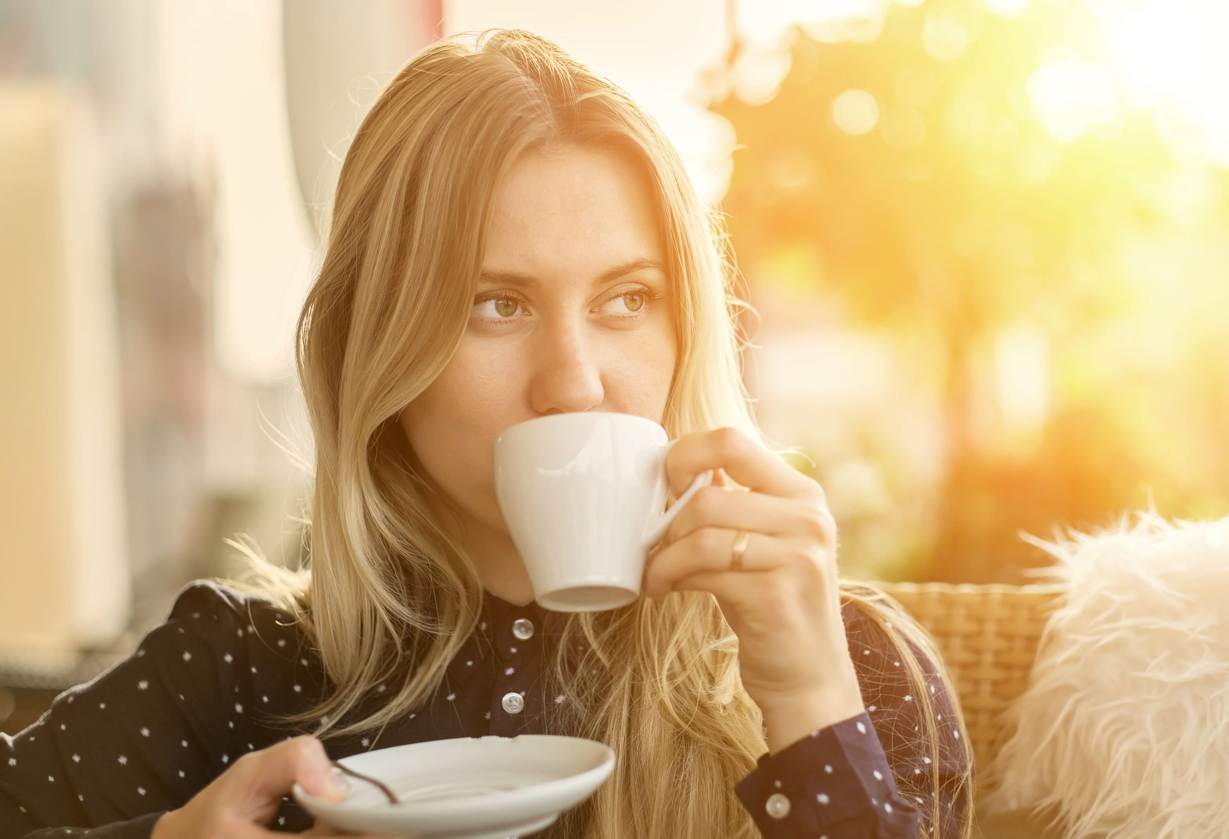 45957792 - beautiful blonde female drink coffee in cafe