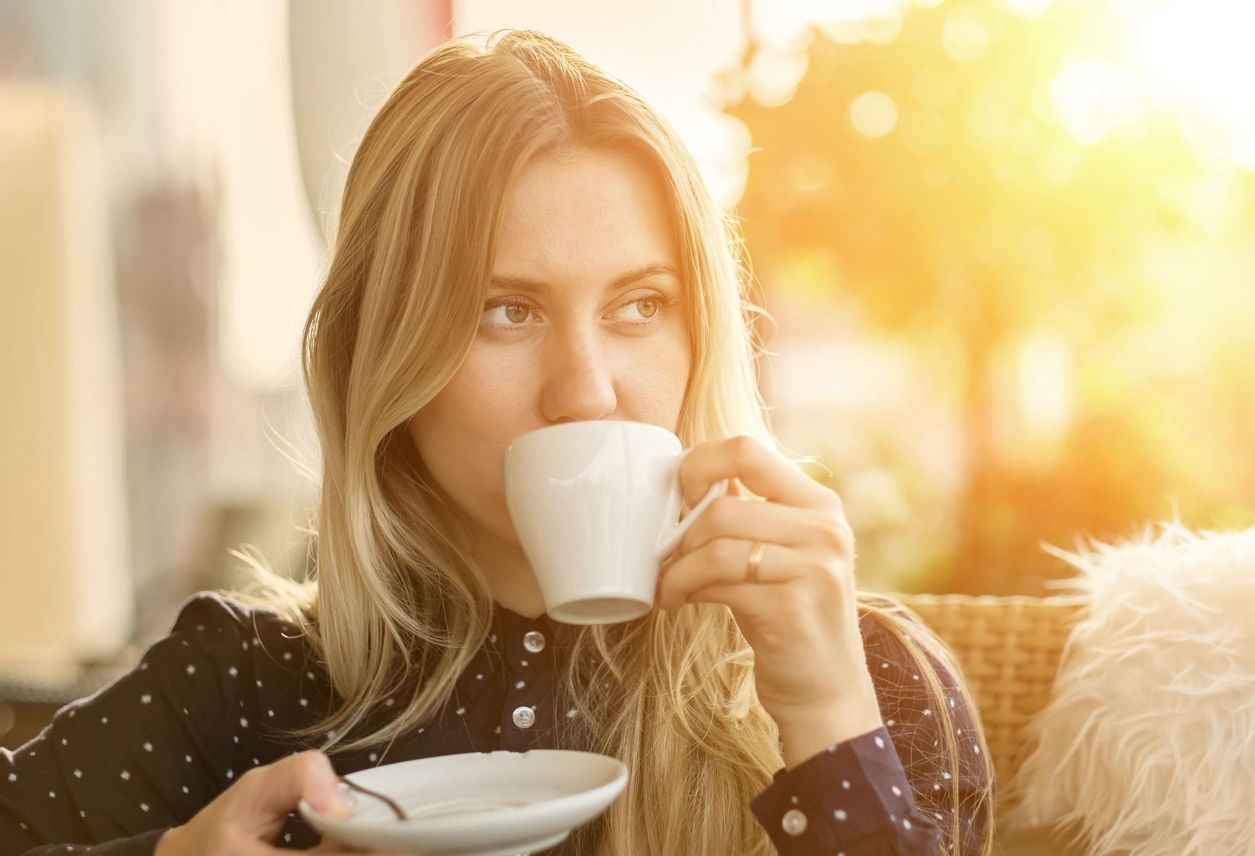 45957792 - beautiful blonde female drink coffee in cafe