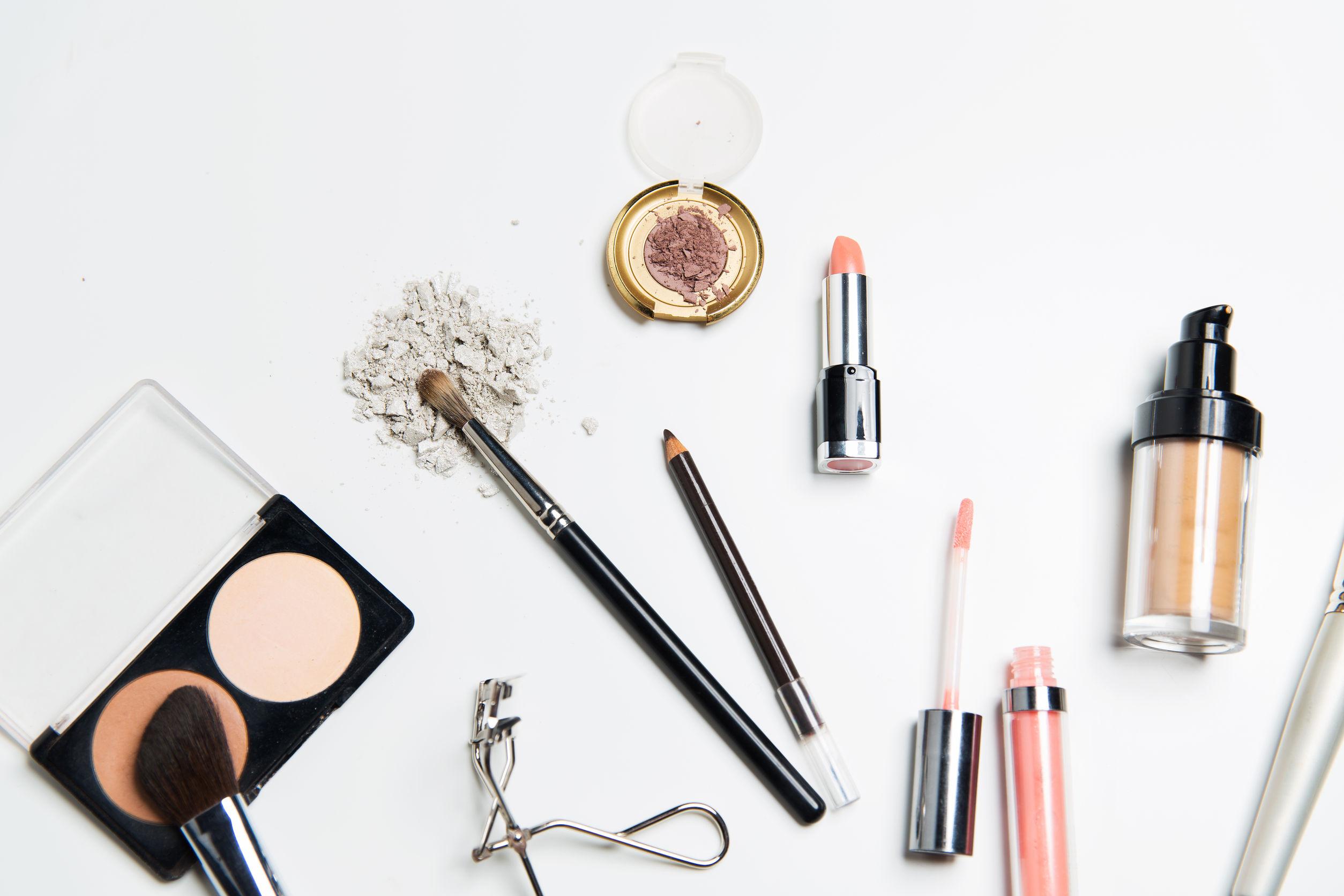 52115493 - cosmetics, makeup and beauty concept - close up of makeup stuff