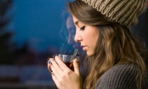17626230 - portrait of a dreamy young brunette with hot tea.