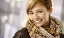 22070609 - closeup portrait of beautiful young woman wearing scarf, smiling.