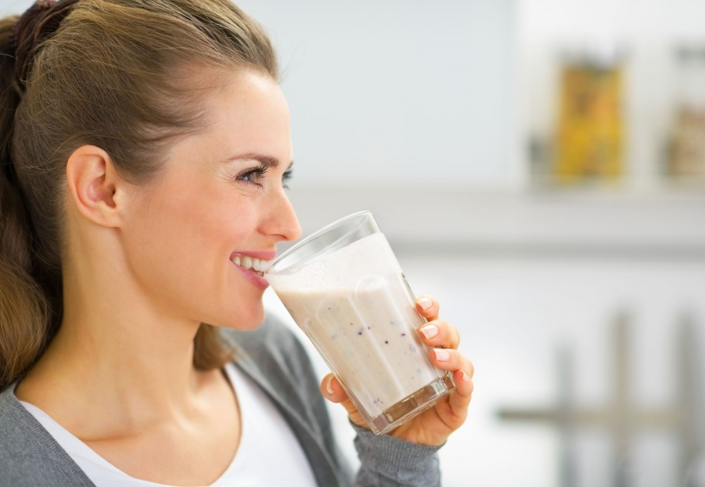 31040795 - profile portrait of happy young woman drinking fresh smoothie