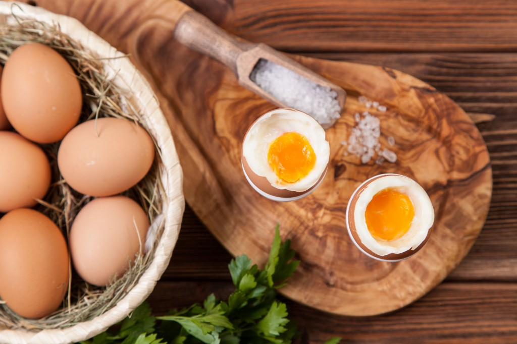 43524831 - boiled eggs on a wooden background.