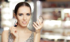 48132823 - glamour woman with lipstick and make-up mirror