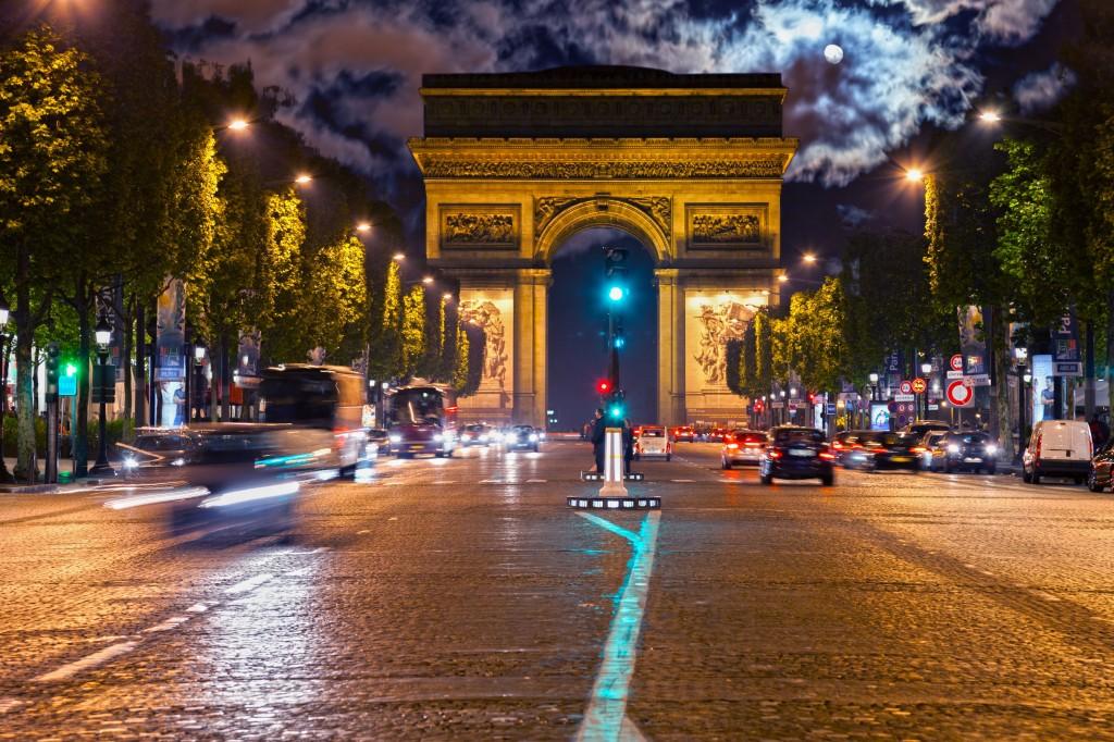 22450356 - arc de triomphe and champs-elysees avenue at night in paris, france