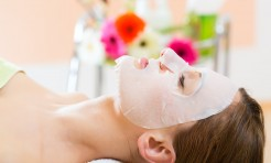 25774809 - wellness - woman receiving facial mask in spa for clean skin