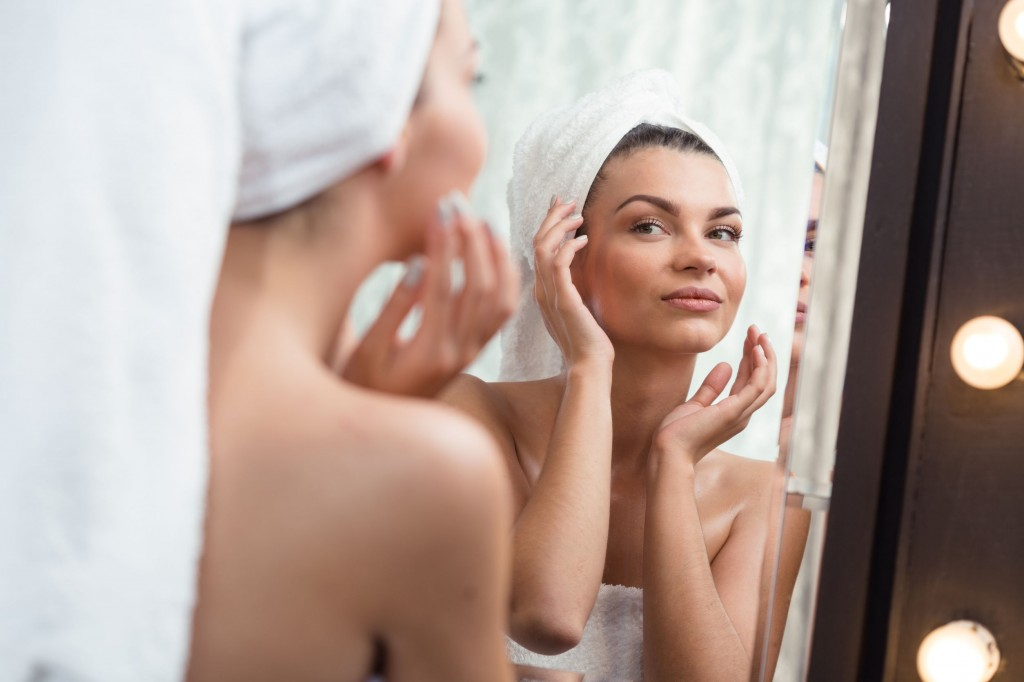 47016563 - image of a beautiful content woman pampering her skin