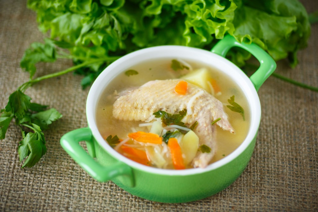 33995055 - chicken soup with noodles in a bowl