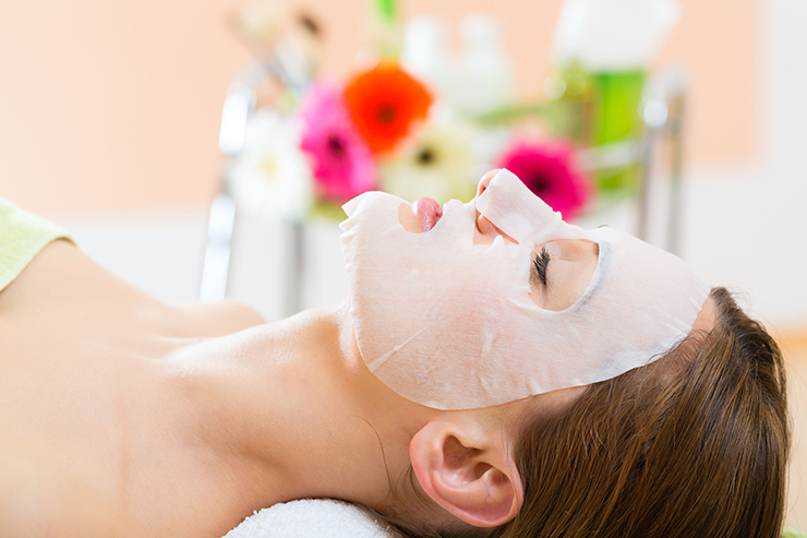 22880462 - wellness - woman receiving facial mask in spa for clean skin