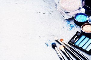 38946166 - various makeup products in blue tone with copyspace