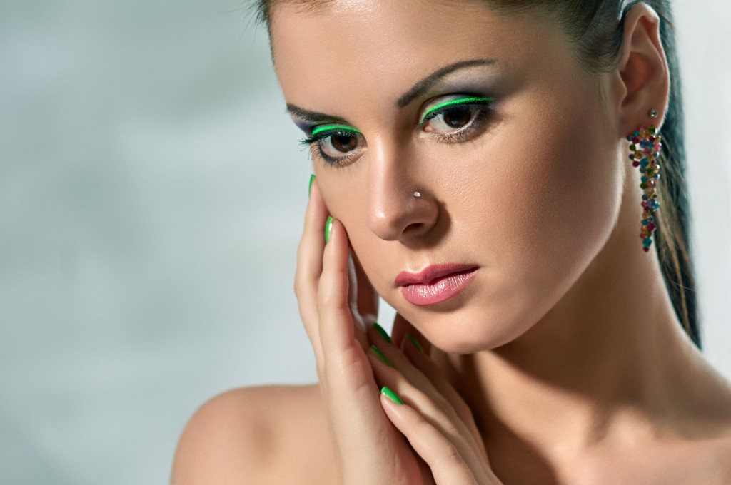 39787420 - beautiful brunette girl. beauty model woman with green makeup.