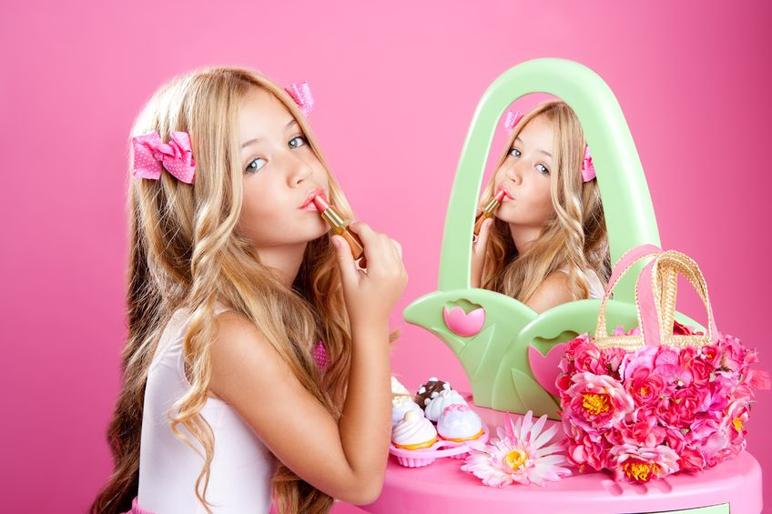 10214376 - fashion little doll girl in pink vanity mirror with lipstick