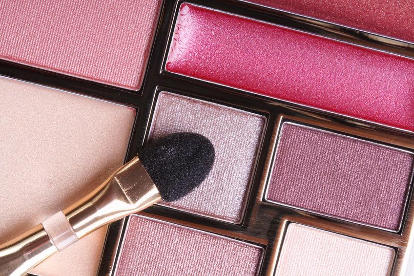 25273837 - eyeshadow in pink tones and lip gloss and applicator close-up. macro