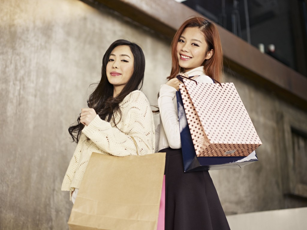 28924395 - young asian women with shopping bags