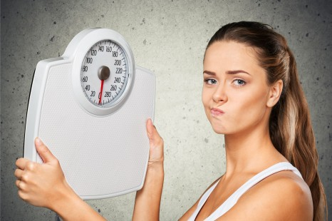 42646543 - dieting, weight scale, women.