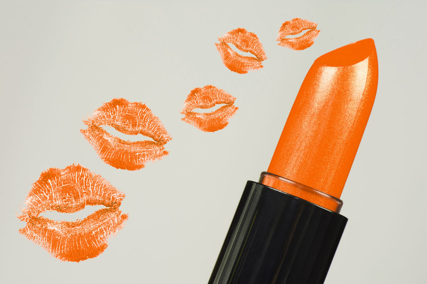 67256810 - orange lipstick and orange mouths, kisses are on gray background.