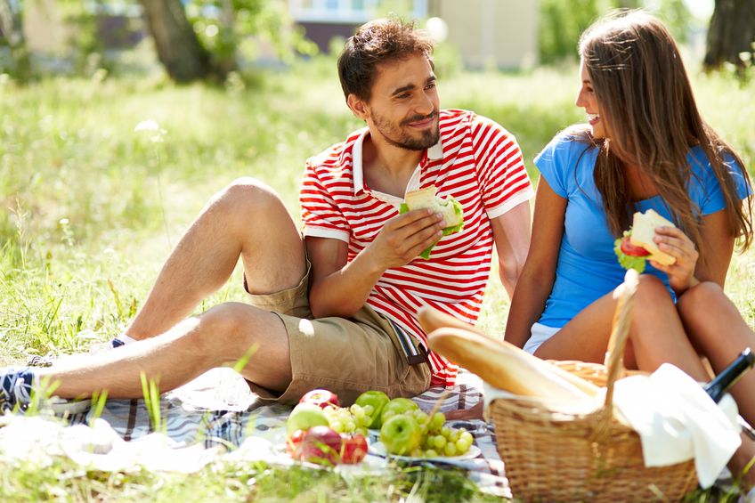 21643901 - happy young dates having picnic in the country