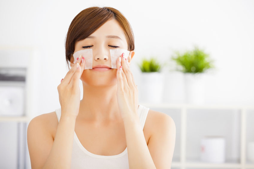 33291709 - beautiful  young woman cleaning her face with cotton