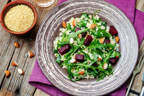 57615858 - beet millet almonds arugula salad. toning. selective focus
