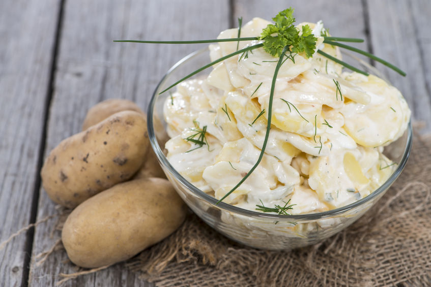 23467503 - portion of homemade potato salad with fresh herbs