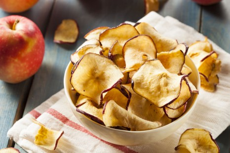 31741047 - baked dehydrated apples chips in a bowl