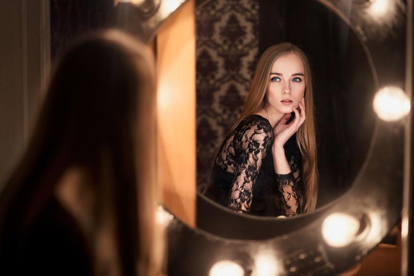 37842555 - beautiful fashion model woman posing near the mirror