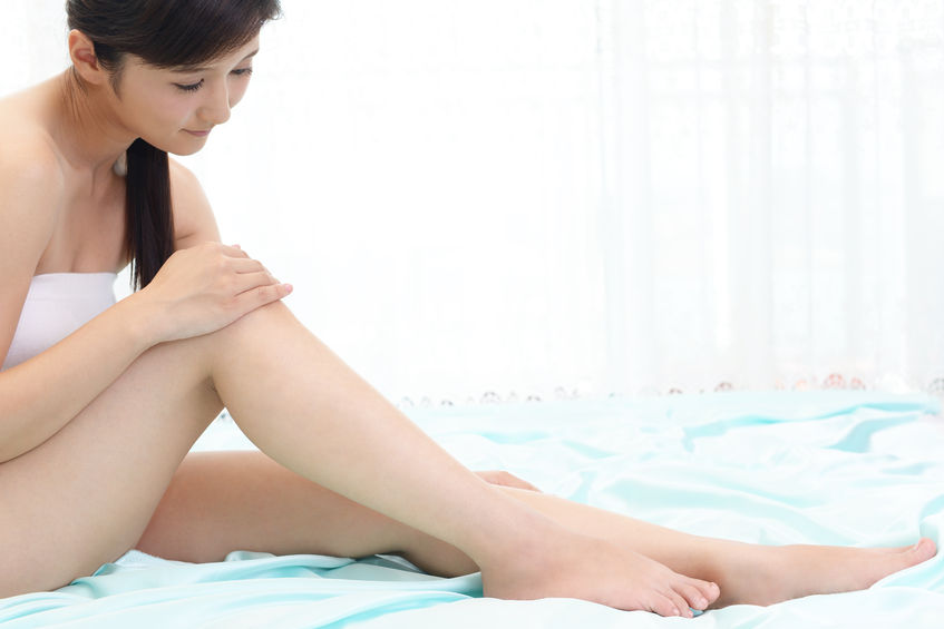 57241041 - woman who takes care of her legs