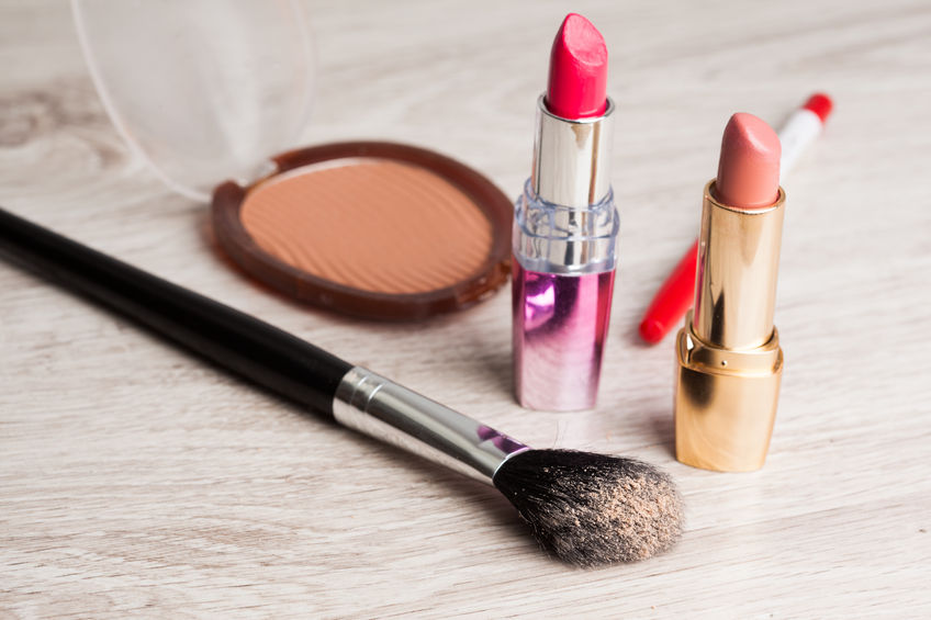 27925931 - various cosmetics on wooden table