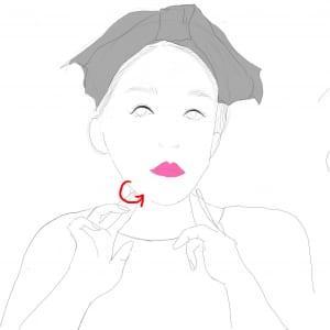 次に、耳の下あたりのエラ部分に人差し指と中指を置き、内側に押し込むようにエラ下まで3〜4回ほど軽くさすります